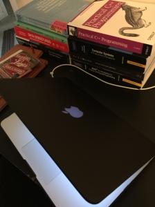A Speck SmartShell encases my MacBook Pro